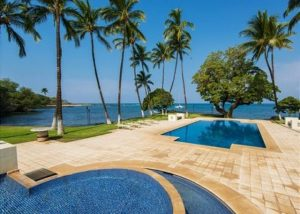 honualai home puako beautiful pool and puako bay views with tall palm trees swaying in the breeze