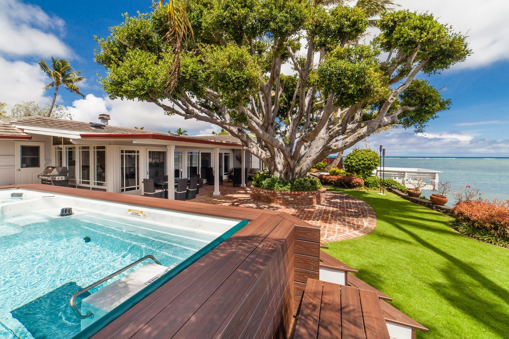 exterior of vacation rental with pool and ocean view
