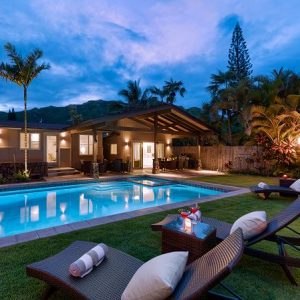exterior of oahu vacation rental with pool and purple sky